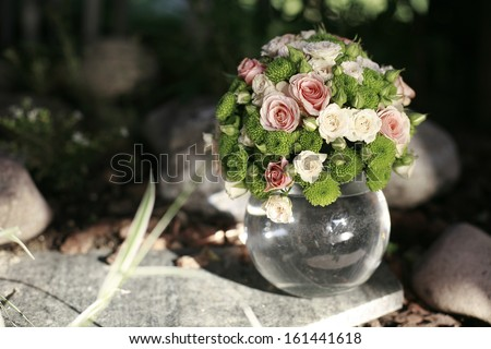 Wedding bouquet of pink and white roses in the glass sphere , wedding bouquet - stock photo