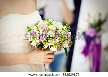 Wedding bouquet of purple roses