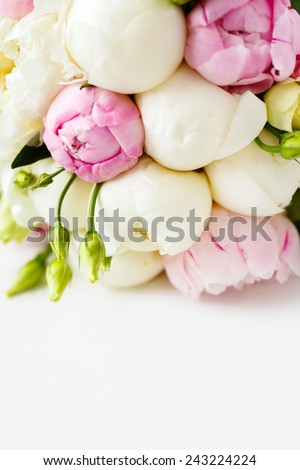 Wedding bouquet of ranunculus and peony flowers on white background. Space for text. Selective focus. - stock photo