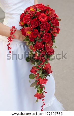 wedding bouquet of red roses and leaves - stock photo