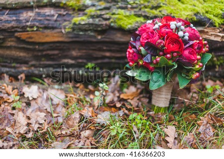 wedding bouquet of red roses and succulents outdoor