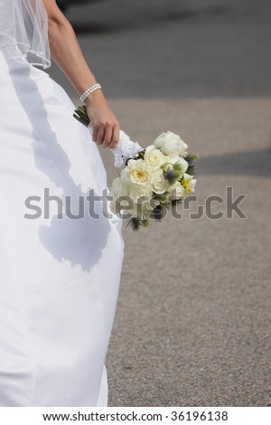 Wedding bouquet of roses held in hand of bride