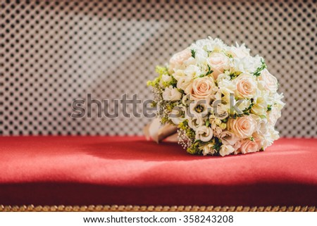 Wedding bouquet of roses on a red velvet - stock photo