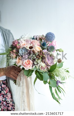 wedding bouquet of the bride - colorful wedding flowers.