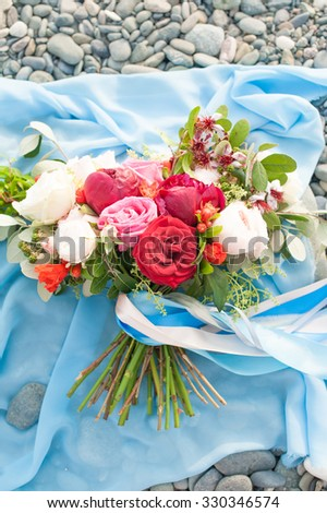 Wedding bouquet of the bride - colorful wedding flowers. Sea concept. - stock photo