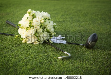 Wedding bouquet of white flowers on the golf field - stock photo
