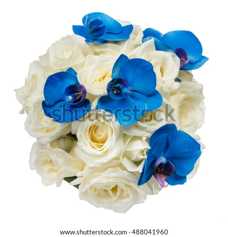Wedding bouquet of white roses and blue orchid