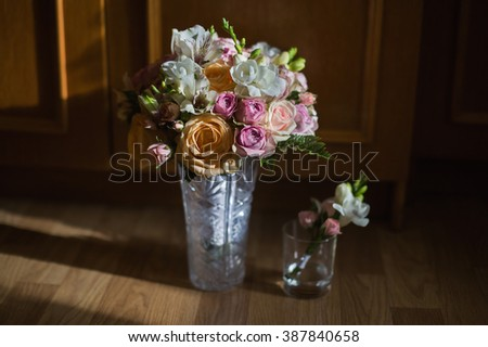 wedding bouquet of yellow roses, pink and white roses, purple flowers, wedding boutonniere of pink roses and white flower - stock photo