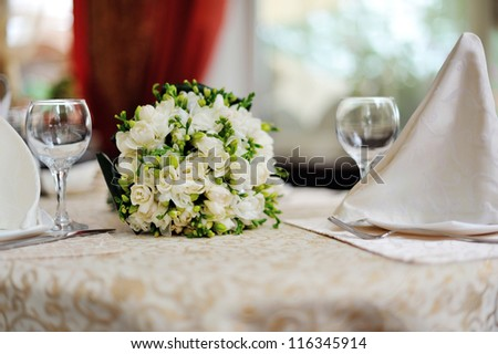 wedding bouquet on a served table in restaurant