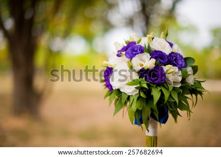 Wedding bouquet on a tree - stock photo