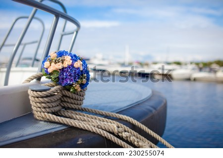 Wedding bouquet on a yacht - stock photo