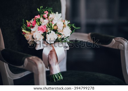 Wedding Bouquet on green  cloth chair with tape
