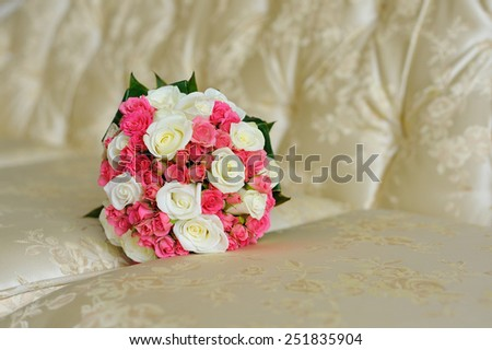 wedding bouquet on sofa - stock photo