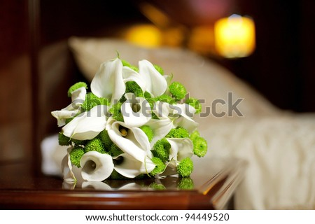 Wedding bouquet on table in bedroom - stock photo