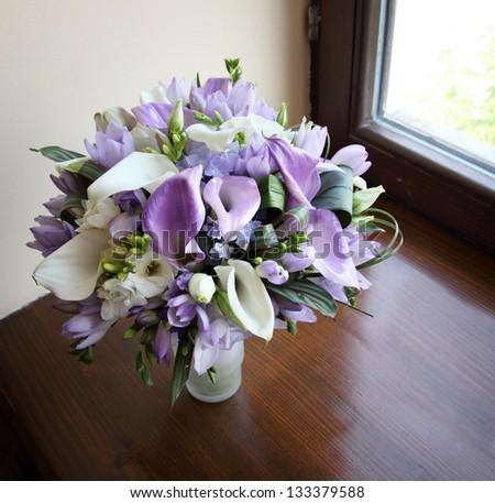 wedding bouquet on the window - stock photo