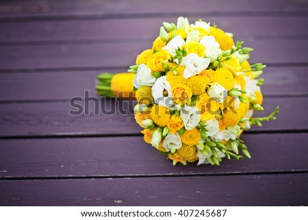 Wedding bouquet on the wooden background