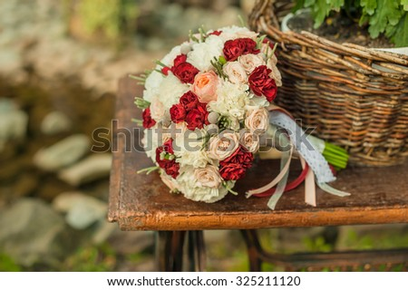 wedding bouquet on vintage furniture - stock photo