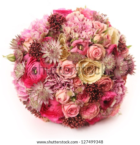 wedding bouquet with Astrantia, Skimma, Brassica, rose bush, Ranunculus asiaticus, cloves, - stock photo