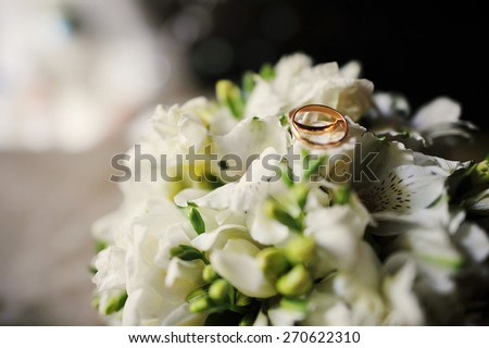 Wedding bouquet with engagement rings - stock photo