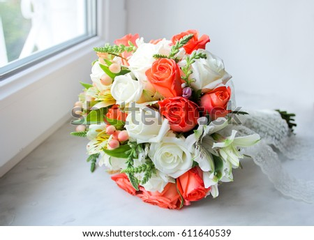 Wedding bouquet orange white roses on stock photo royalty free wedding bouquet with orange and white roses on windowsill close up of bride bouquets with mightylinksfo