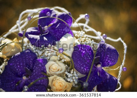 wedding bouquet with purple orchids