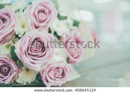 Wedding Bouquet with vintage filtered,  Flower bouquet of roses on wooden background, selective focus, Shallow depth of field - stock photo