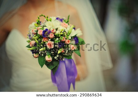 wedding bouquet with violet ribbon - stock photo