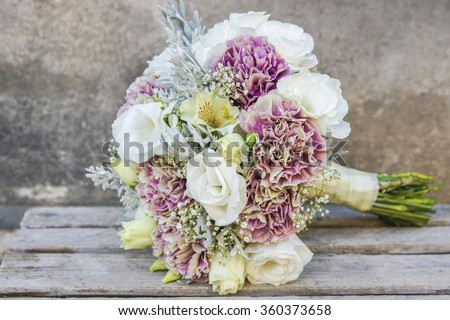 Wedding bouquet with white eustomas and pink carnations - stock photo