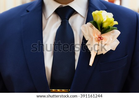 Wedding boutonniere on groom's suit