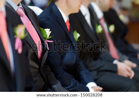 Wedding boutonniere on suit jacket of groom's man - stock photo