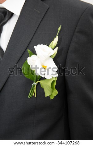 Wedding boutonniere on suit of groom wedding concept