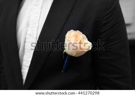 Wedding boutonniere on suit of the groom - stock photo