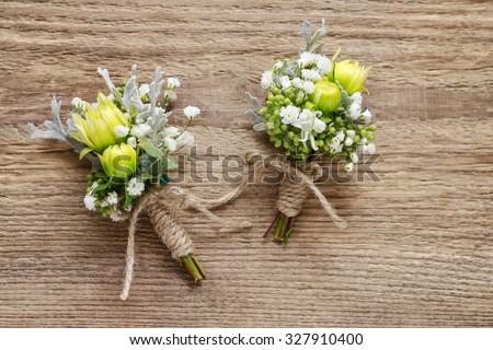 Wedding boutonniere with yellow chrysanthemum and gypsophila paniculata - stock photo