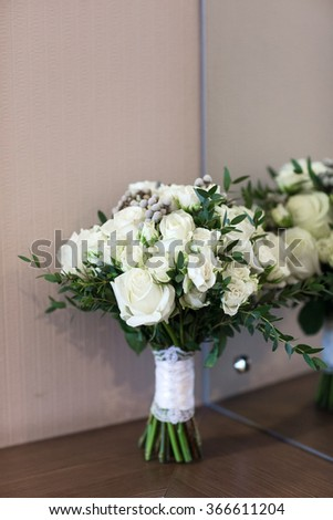 Wedding bridal bouquet. Beautiful flowers are collected in a bouquet for a wedding. - stock photo