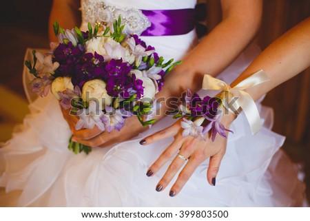 Wedding Bridal bouquet. Bracelet of flowers on hand bridesmaids - stock photo