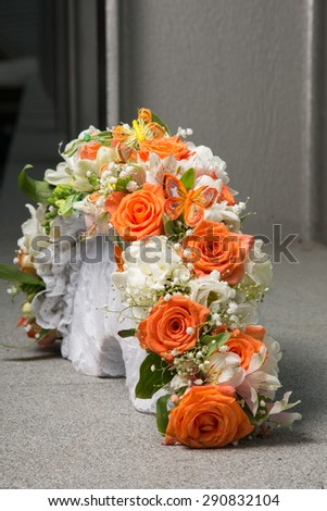 Wedding bridal bouquet with orange roses and butterfly - stock photo
