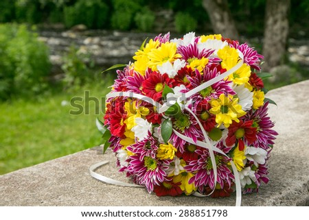 Wedding bridal bouquet with yellow, red and white chrysanthemums - stock photo