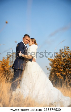 Wedding. Bride and Groom  at autumn forest - stock photo