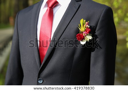 wedding buttonhole on suit - stock photo
