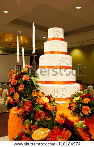 wedding cake and bouquets on table - stock photo