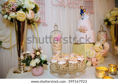 Wedding cake and candy bar. Table with sweets
