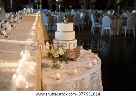 Wedding cake at wedding reception head table - stock photo