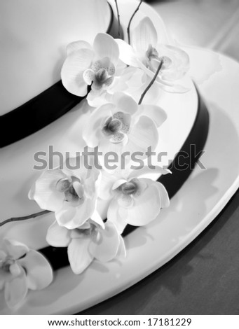 Wedding Cake black and white with orchid flowers, vertical image - stock photo