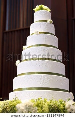 Wedding cake decorate with flower on table in wedding party - stock photo