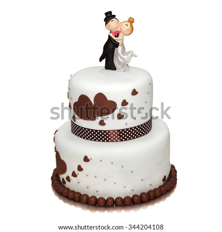 wedding cake decorated with figures of the newlyweds,  isolated