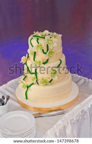 Wedding cake decorated with orchids