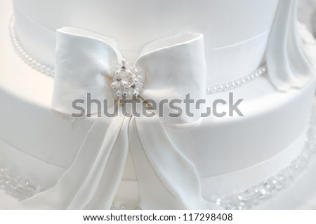 Wedding cake detail - a ribbon with pearls - stock photo