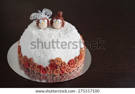 Wedding cake on a dark background - stock photo