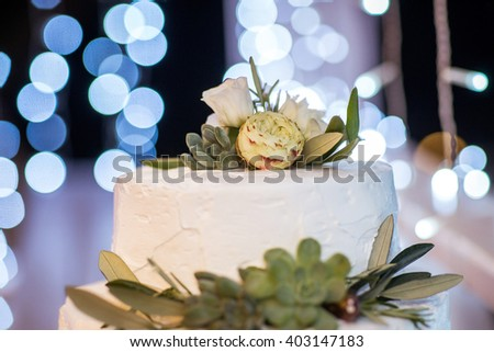 Wedding cake. Top of cake with flowers and decor.