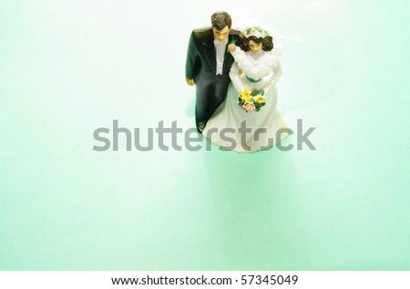 wedding cake-topper couple, bride and groom - stock photo